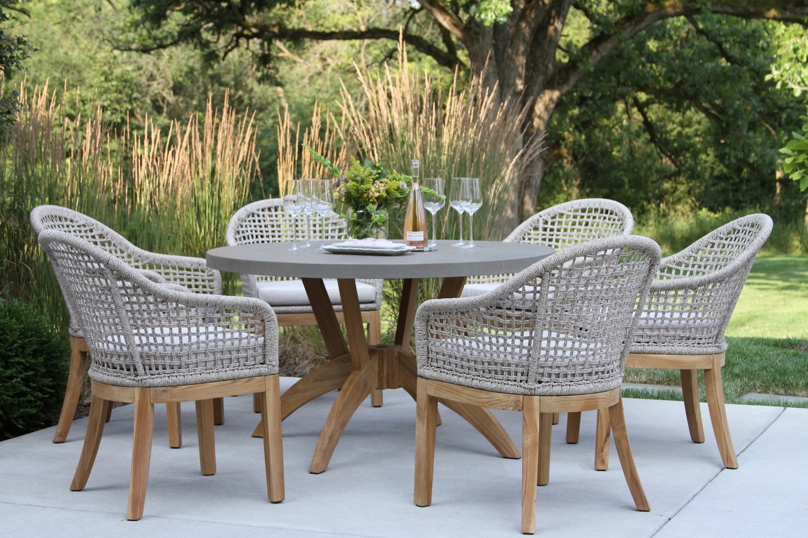 Picture of: Nautical Composite Teak Hardwood Round Dining Table